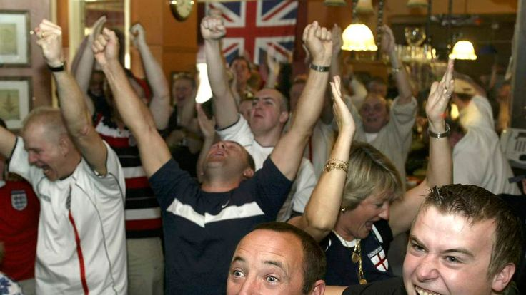 ENGLAND FAN'S CELEBRATE AS THEY WATCH THE WORLD CUP MATCH INSCARBOROUGH.