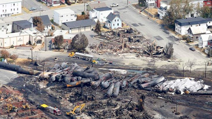 The remains of a burnt train are seen in Lac-Megantic, Canada