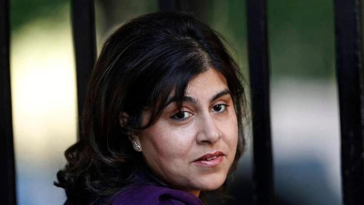 Britain's state minister Sayeeda Warsi arrives at Number 10 Downing Street in London