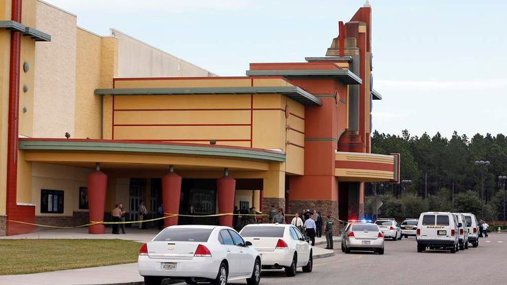 Police tape surrounds the Cobb Grove 16 movie theater in Wesley Chapel, Florida