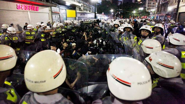 Police officers detain demonstrators during a protest against Brazil's hosting of the 2014 World Cup, in Sao Paulo