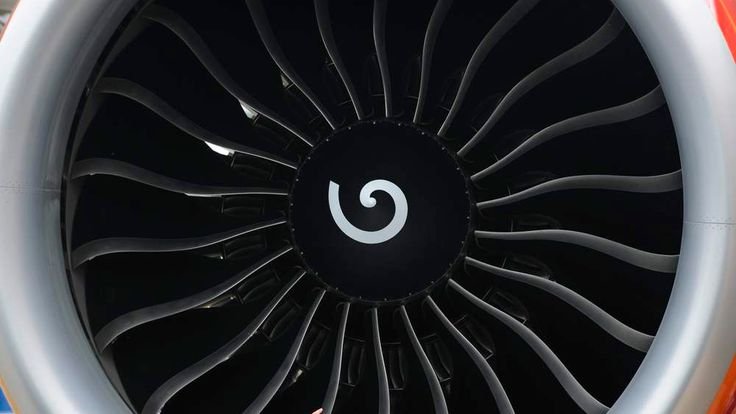 Business visitors view a jet engine on the second day of the Farnborough International Airshow in south England