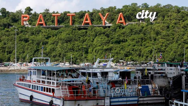 Tourists board a boat in Pattaya a day after the ASEAN Summit was cancelled.