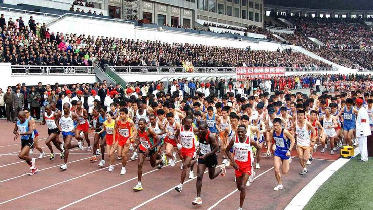 Runners leave the starting line during the IAAF Mangyongdae Prize Marathon at the Kim Il Sung Stadium in Pyongyang
