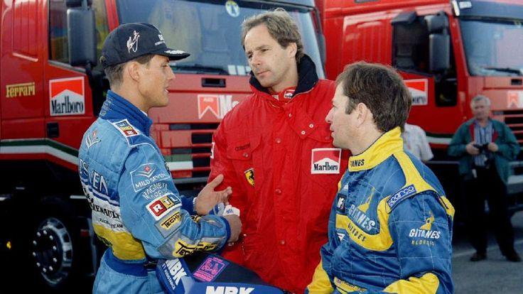 German Formula One driver Michael Schumacher (L) talks to Austrian driver Gerhard Berger (C) and Mar..