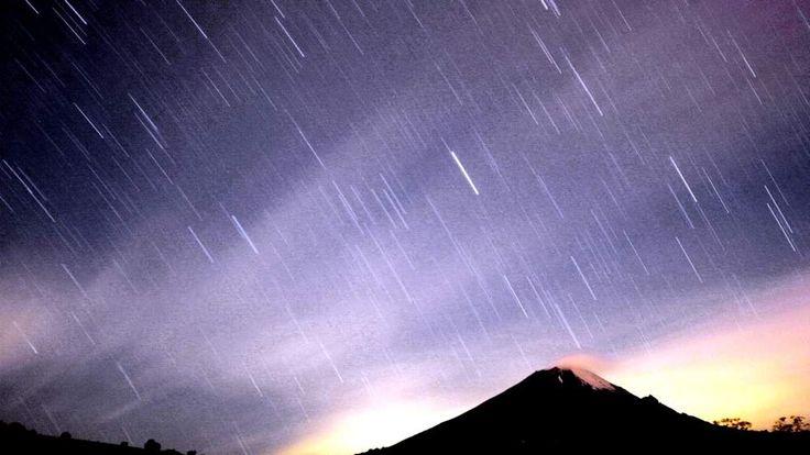 Meteor shower lights up sky over Mexican volcano Popocatepetl near village San Nicolas de los Ranchos in Mexican state of Puebla