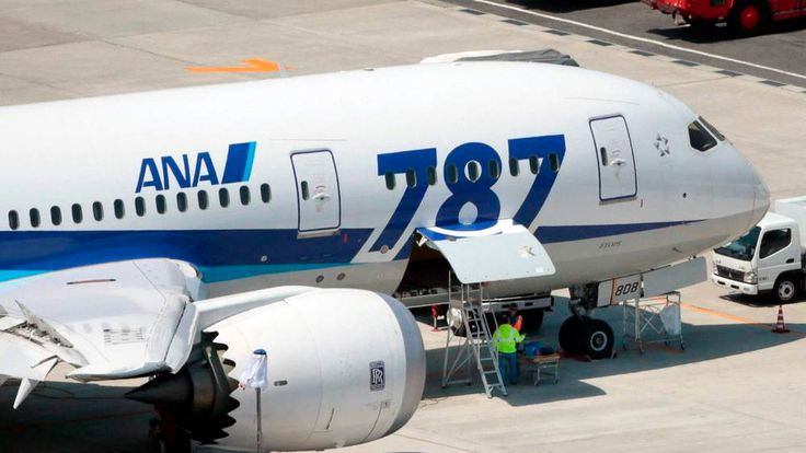 An ANA's Boeing Co's 787 Dreamliner plane receives restoration work at Okayama airport in Okayama, Japan
