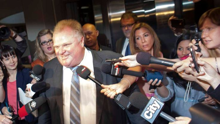 Toronto Mayor Ford is swarmed by reporters as he enters his offices at Toronto City Hall