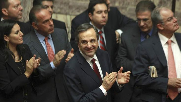 Greece's Prime Minister Antonis Samaras and his party's lawmakers