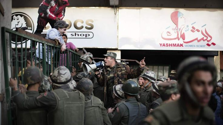 An Egyptian soldier tries to calm down anti President Mohamed Morsi protesters