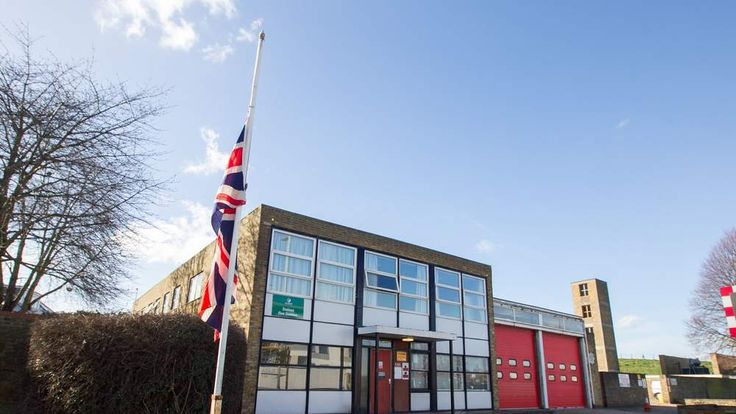 The Union flag flies at half mast at Staines fire station after the death of firefighter Clifford Cox.