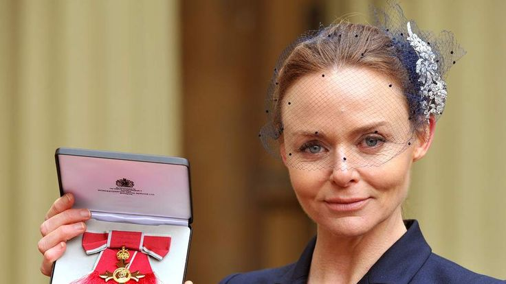 Fashion designer Stella McCartney holds her Officer of the British Empire (OBE) award.