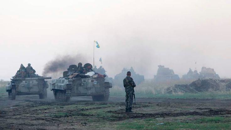 A Ukrainian military convoy is seen in a field in Luhansk region