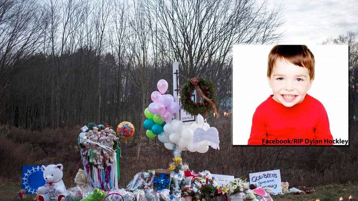 A memorial is seen along the road to Sandy Hook Elementary School a day after a mass shooting in Newtown, Connecticut
