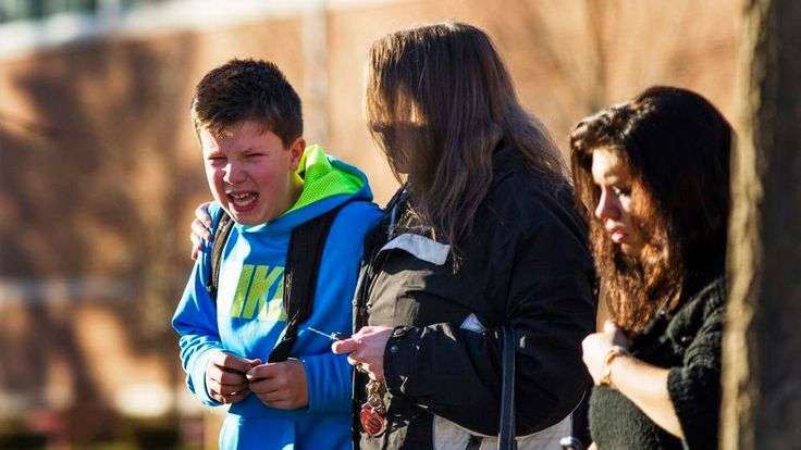 A boy weeps as he is told what happened