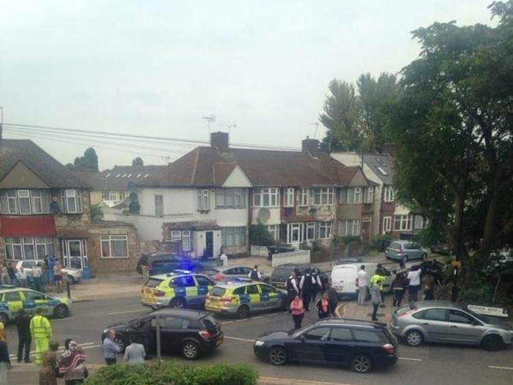 The scene of a reported stabbing in Edmonton, north London: Pic: @redbutdred