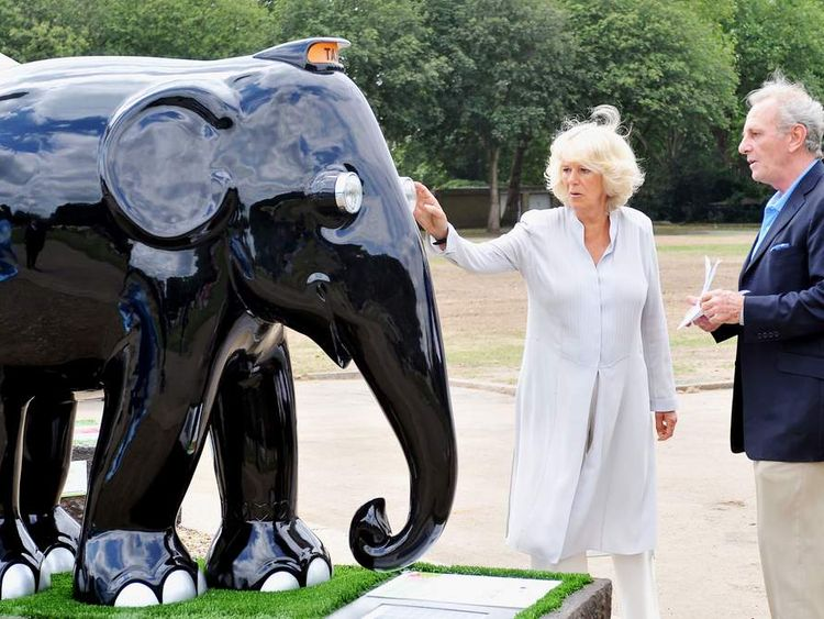Camilla, Duchess of Cornwall is shown an elephant sculpture designed in the style of a London taxi, as she is escorted around the Elephant Parade exhibition at Chelsea Hospital Gardens by her brother, Mark Shand.