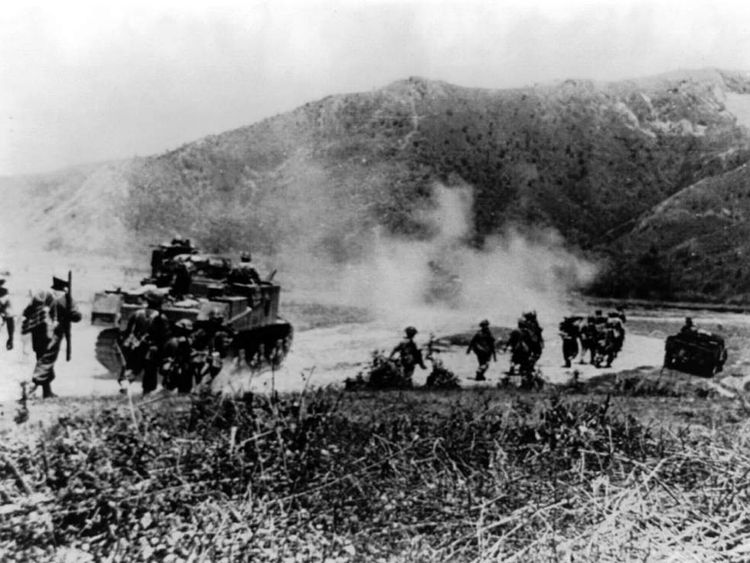 Gurkhas and an M3 Grant tank advance on Japanese positions on the Imphal-Kohima road in 1944