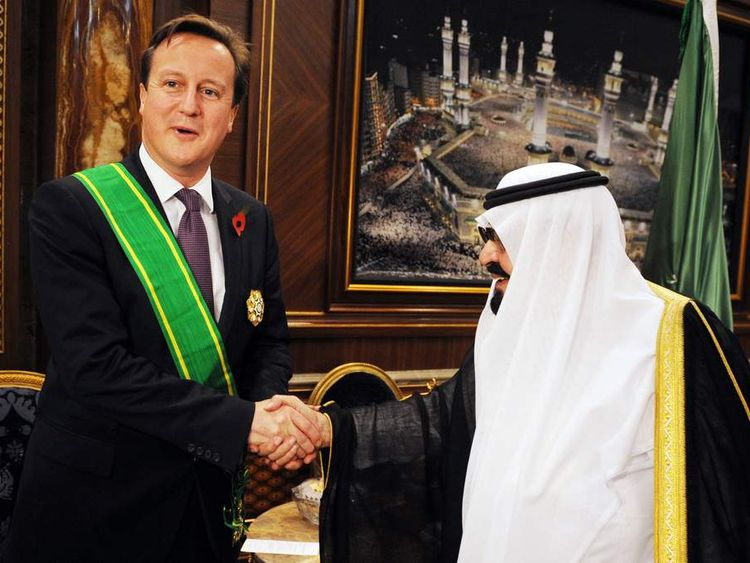 File photo dated 06/11/12 of Prime Minister David Cameron receiving the King Abdullah Decoration One from King Abdullah of Saudi Arabia,