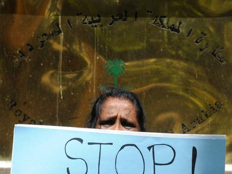 A Sri Lankan woman holds a placard in protest