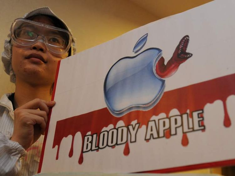 Students protest against Apple and Foxconn, saying it treats its workers like machines