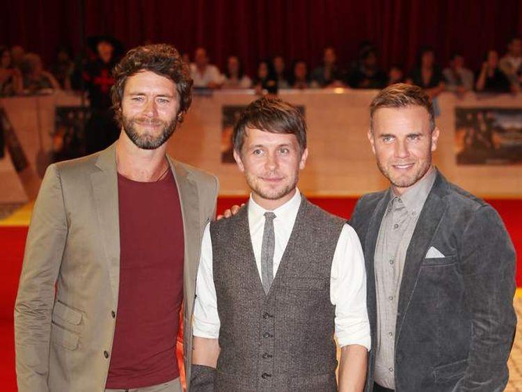Gary Barlow, Howard Donald and Mark Owen