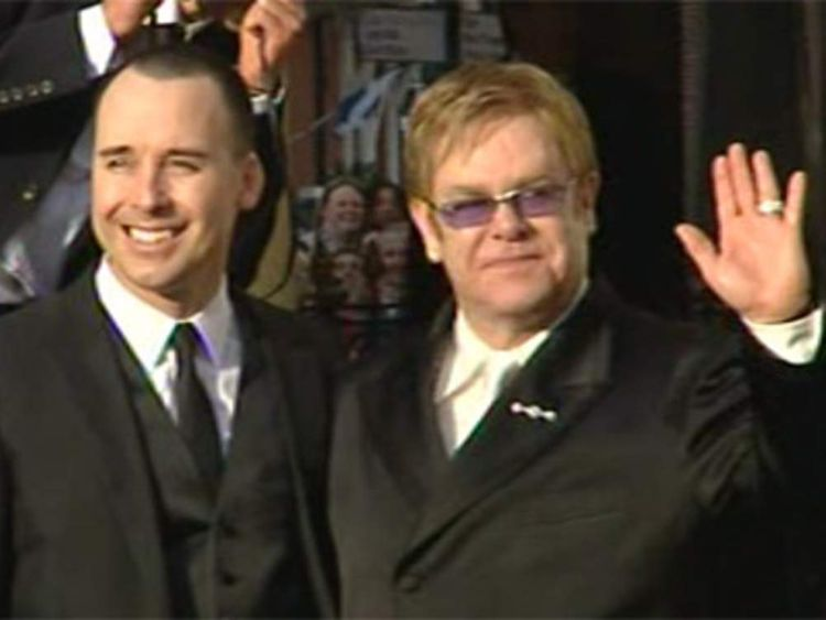 PP Elton John & David Furnish after Elton waves