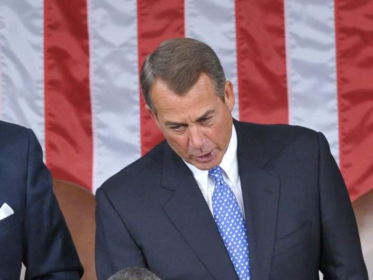 US President Barack Obama (L) greets Speaker John Boehner