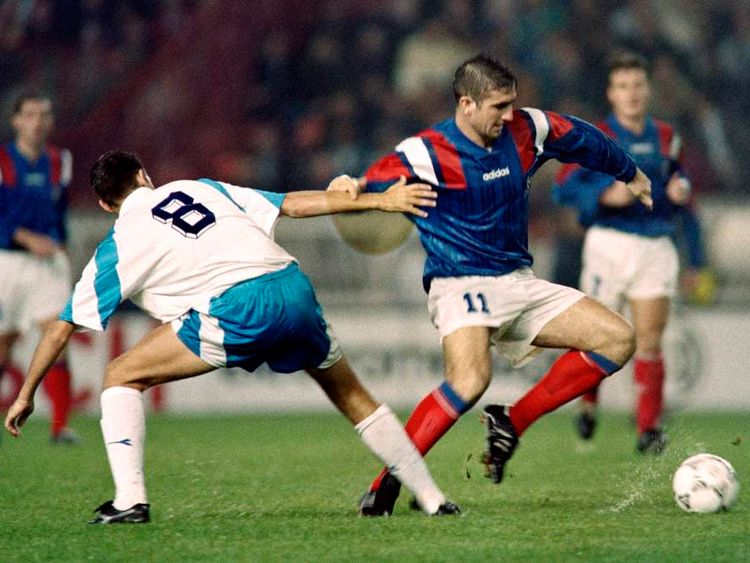 Israeli Nimny (L) loses his balance against France stricker Eric Cantona