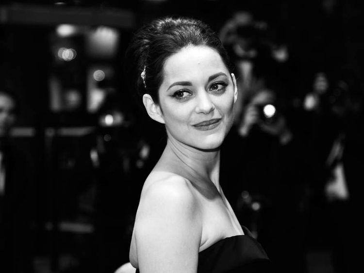 Marion Cotillard leaves after the screening of Rust and Bone in Cannes