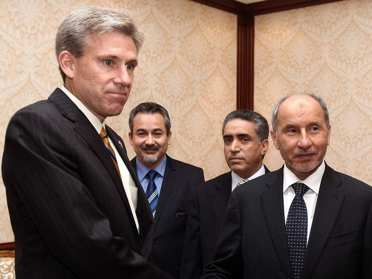 John Christopher Stevens, newly appointed US ambassador to Libya, shakes hands with Libyan National Transitional Council (NTC) chairman Mustafa Abdel Jalil (R) after presenting his credentials during a meeting in Tripoli on June 7, 2012.