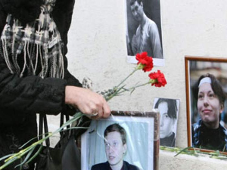 Flowers placed at the spot where Stanislav Markelov and Anastasiya Baburova were gunned down