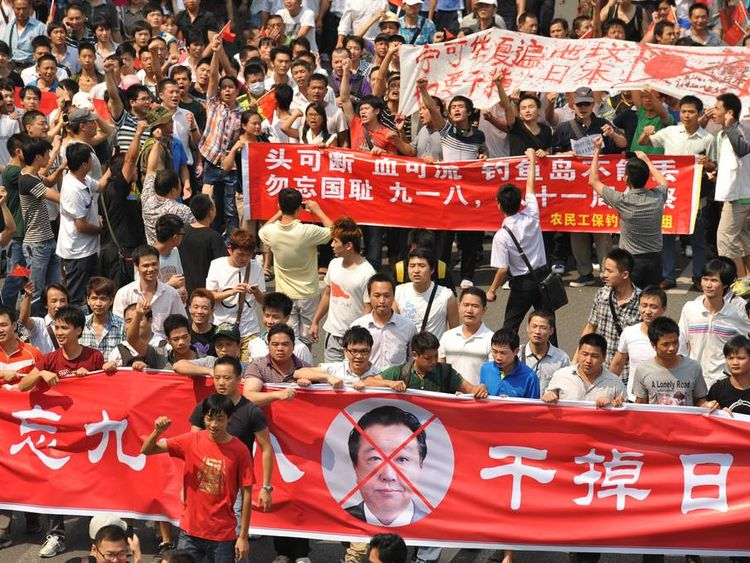Anti-Japan protesters march during a protest over the Diaoyu islands issue, known as the Senkaku islands in Japan, in the southern Chinese city of Shenzhen on September 18, 2012.