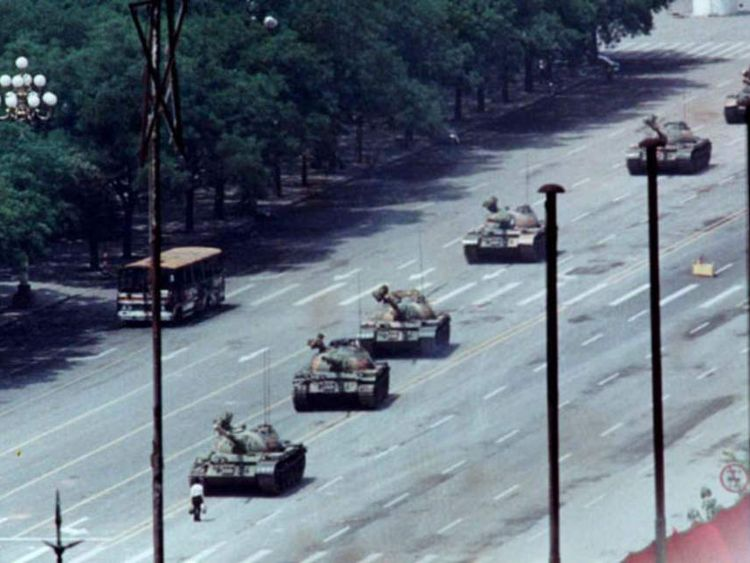 Protester In Front Of Tanks