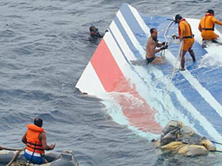 Brazilian Navy sailors pick tail fin from Air France flight AF447 out of the Atlantic Ocean