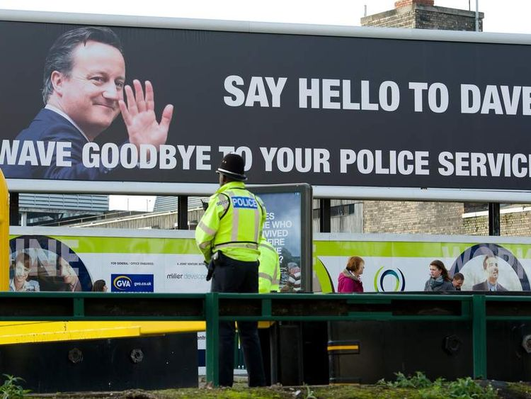 A poster attack Cameron over police cuts