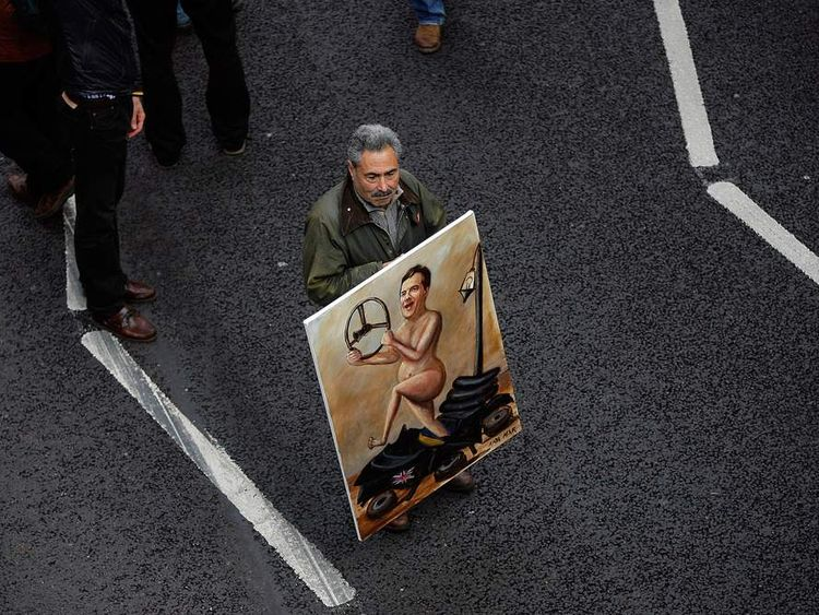 A TUC protester pokes fun at Chancellor George Osborne