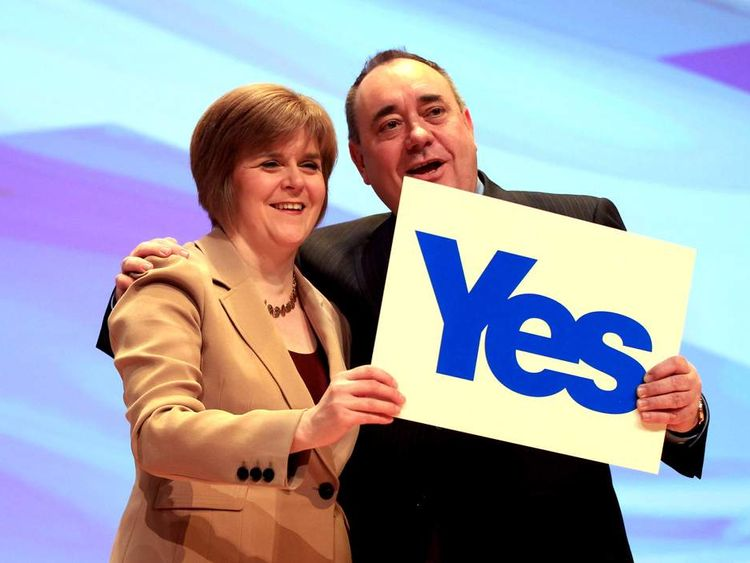 Scottish First Minister Alex Salmond is joined on stage by Deputy First Minister Nicola Sturgeon