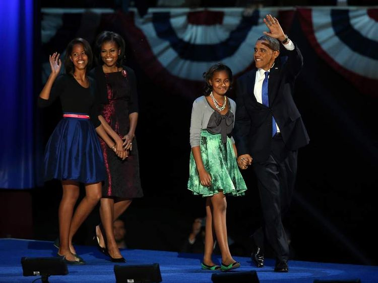 The President and his family - daughters Sasha and Malia and first lady Michelle Obama