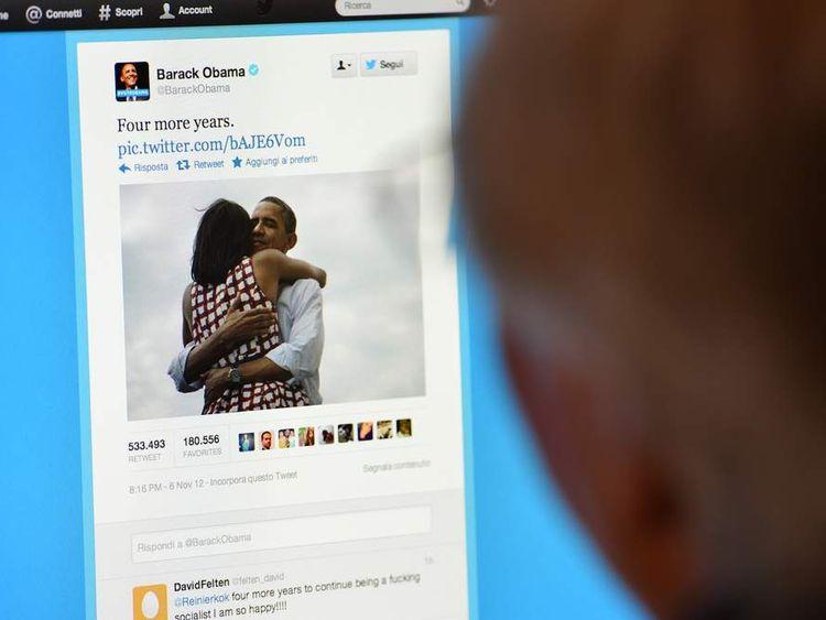 A man reads Barack Obama's tweet