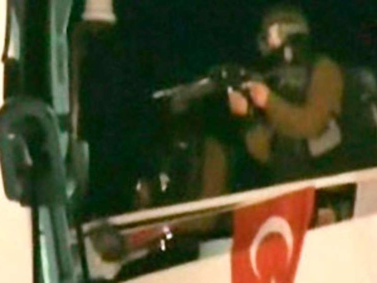 A frame grab shows an Israeli commando landing on a Gaza-bound ship in the Mediterranean Sea