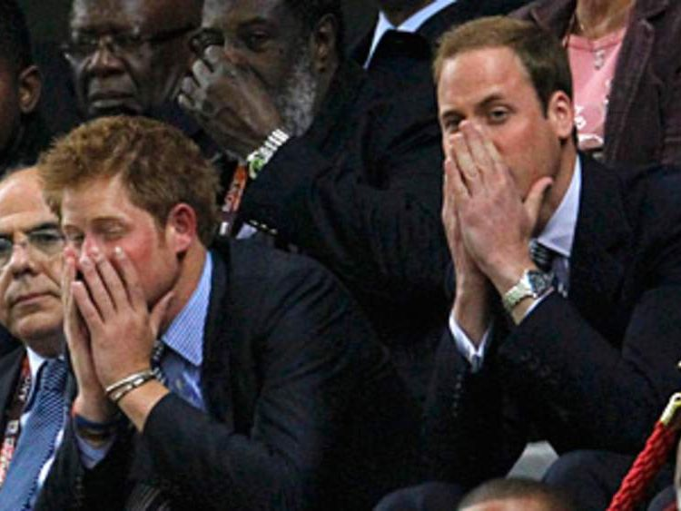 Britain's Princes William and Harry react as they watch the 2010 World Cup Group C soccer match between England and Algeria at Green Point stadium in Cape Town