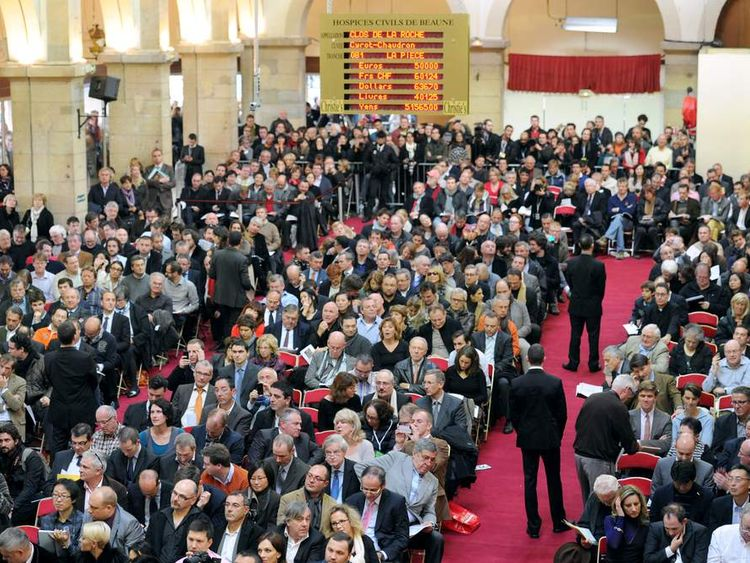 People attend the 152th charity wine auction at the Hospices de Beaune on November 18, 2012 in Beaune, central France