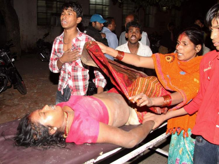 Victim of stampede in India rushed to hospital