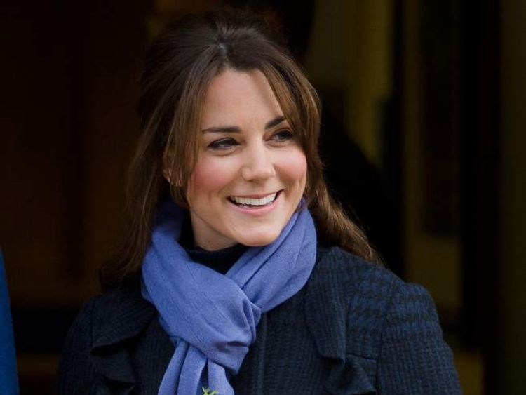 Britain's Catherine, Duchess of Cambridge, wife of Prince WiIliam, leaves the King Edward VII hospital in central London