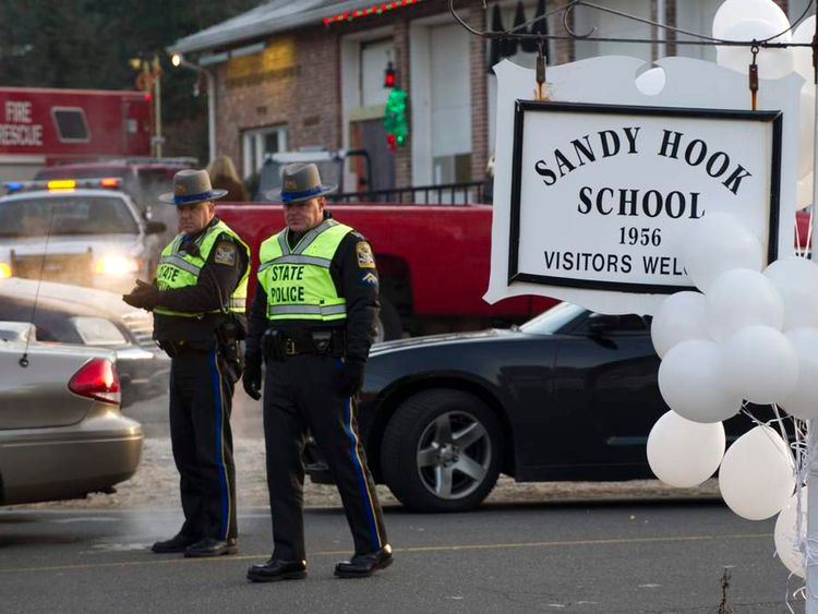 Police guard entrance to Sandy Hook School