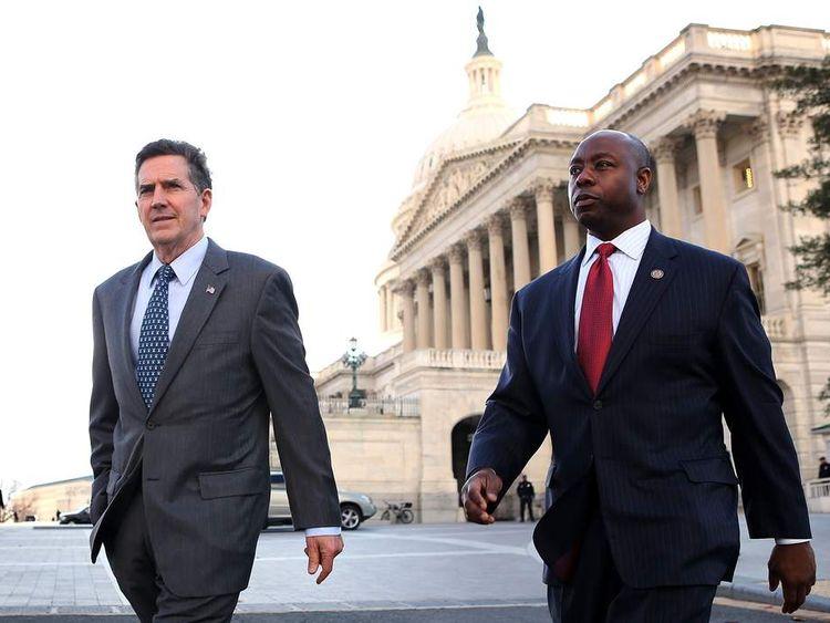 Senator Jim DeMint (L) and South Carolina Representative Tim Scott (R)