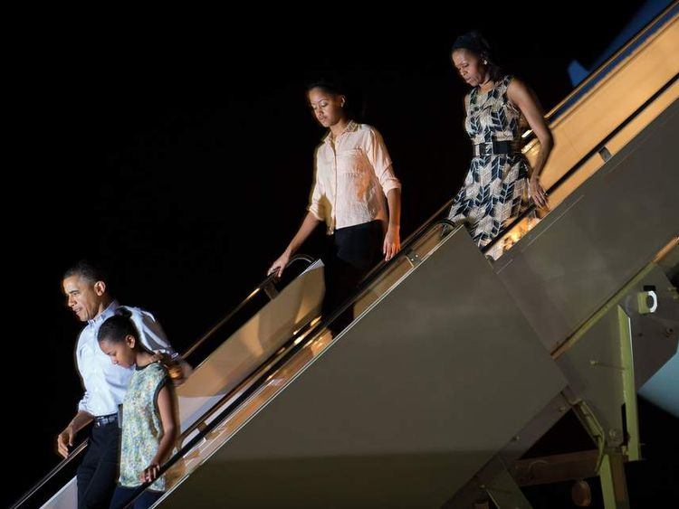 President Barack Obama and his family arrive in Honolulu, Hawaii