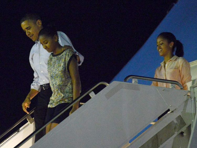 President Obama and his family arrive in Hawaii for Christmas