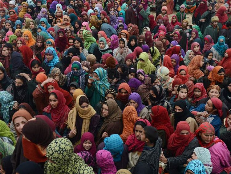 Kashmiri muslim woman shout pro freedom slogans during the funeral of Lashkar-e-Toiba militant, Imtiyaz Ahmed in Pulwama some 55kms south of Srinagar on December 28, 2012